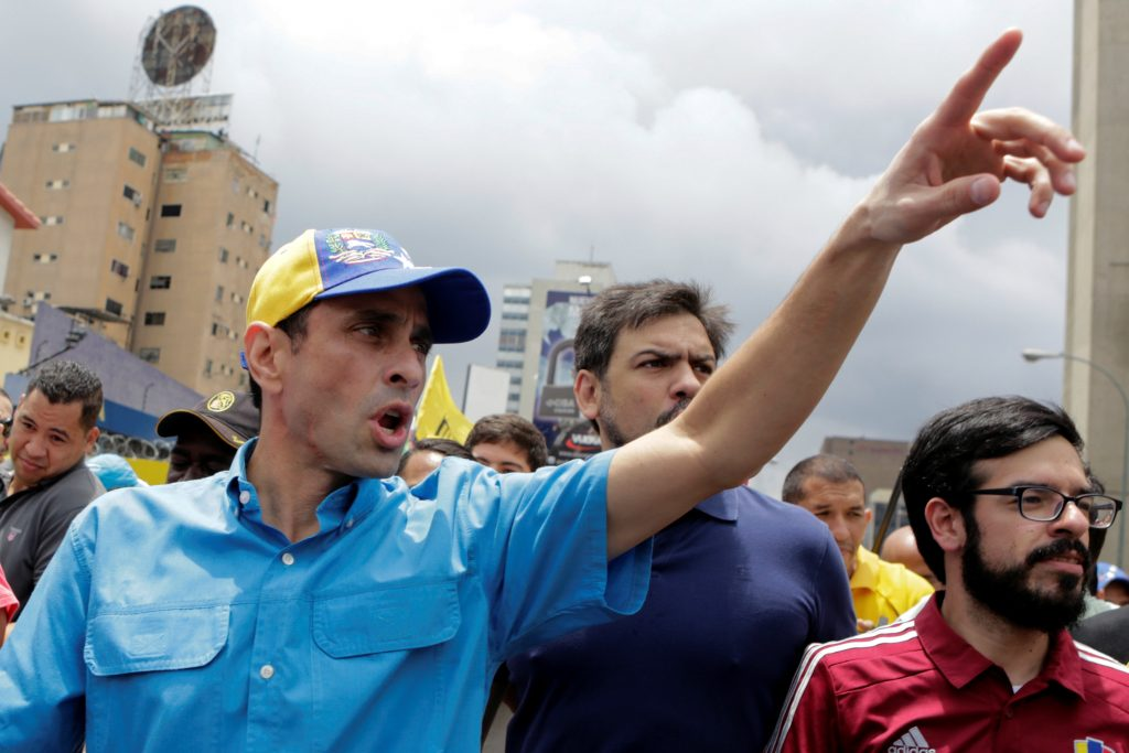 Venezuelan opposition leader and Governor of Miranda state Henrique Capriles (L) greets supporters as he arrives to a rally to demand a referendum to remove President Nicolas Maduro in Caracas, Venezuela, May 14, 2016. REUTERS/Marco Bello