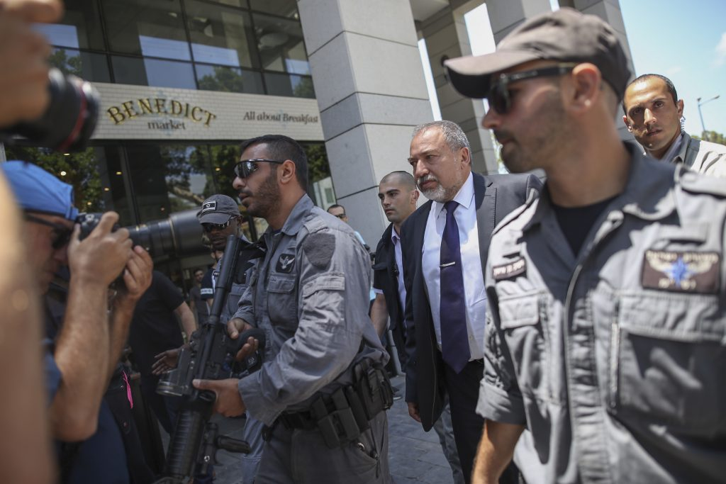 Defense Minister Avigdor Liberman visits the Sarona Market shopping center in Tel Aviv, Thursday, the morning after the fatal terror attack. (Miriam Alster/Flash90)
