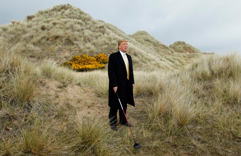 property mogul Donald Trump leads a media event on the sand dunes ...