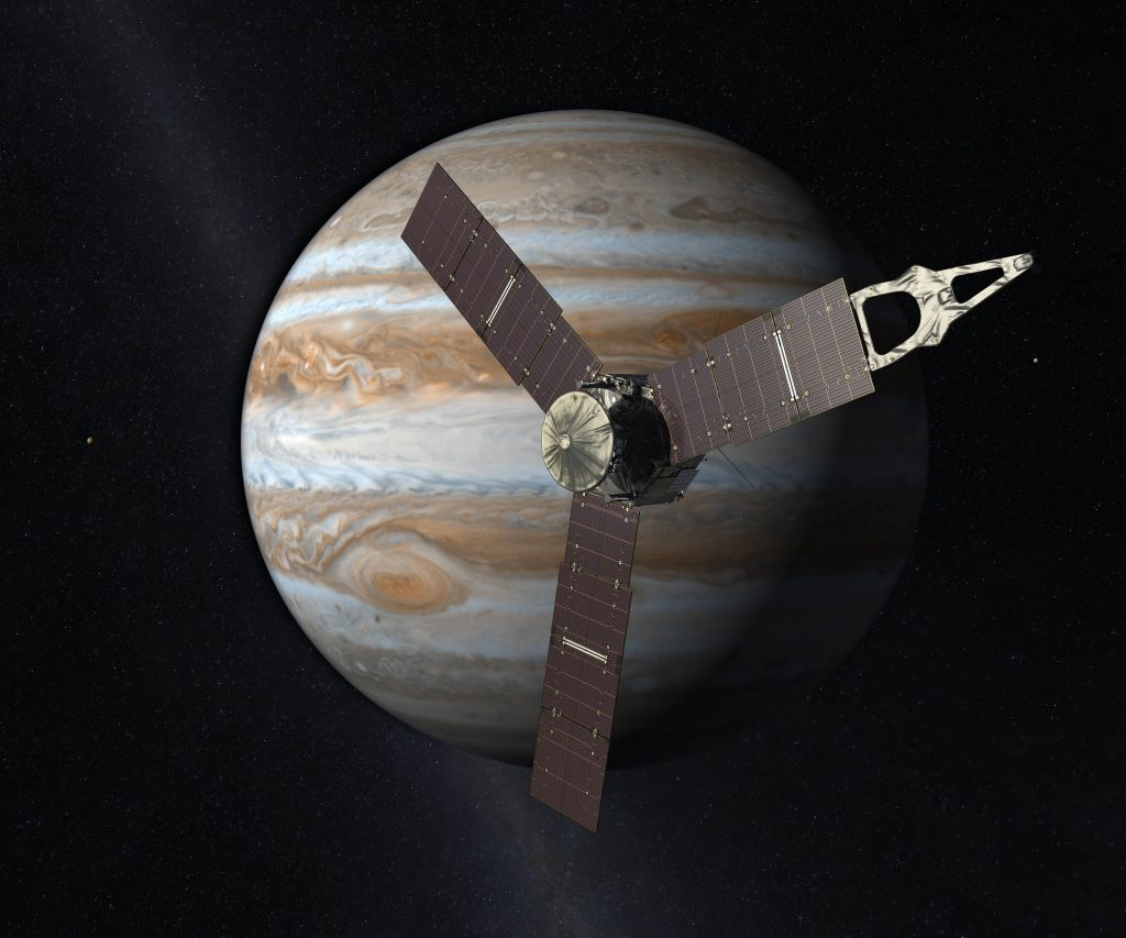 This artist's rendering provided by NASA and JPL-Caltech shows the Juno spacecraft above the planet Jupiter. Five years after its launch from Earth, Juno is scheduled to go into orbit around the gas giant on Monday, July 4, 2016. (NASA/JPL-Caltech via AP)