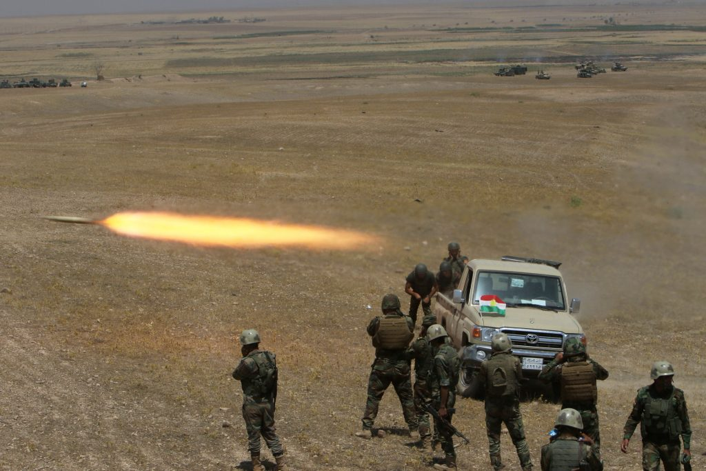 Kurdish Peshmerga forces fire a rocket toward Islamic State terrorists on the southeast of Mosul , Iraq, on Sunday. (Reuters/Azad Lashkari)