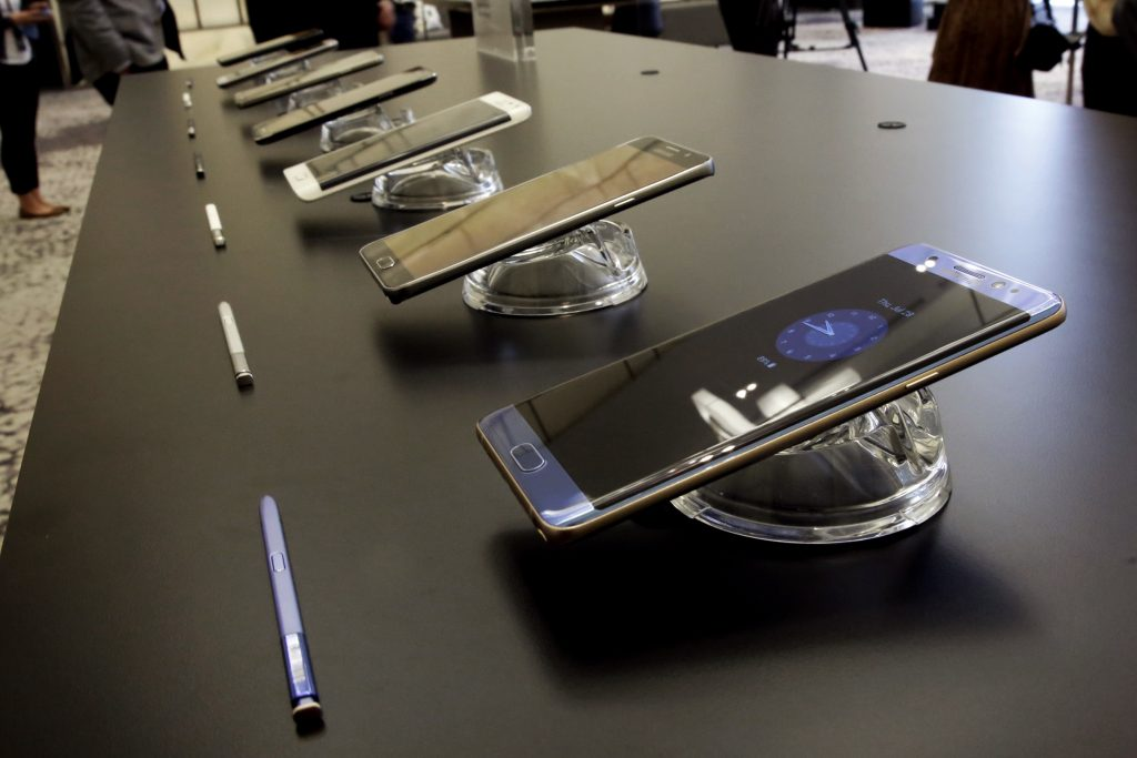 In this July 28, 2016, photo, the Galaxy Note 7, foreground, is displayed in New York. (AP Photo/Richard Drew)
