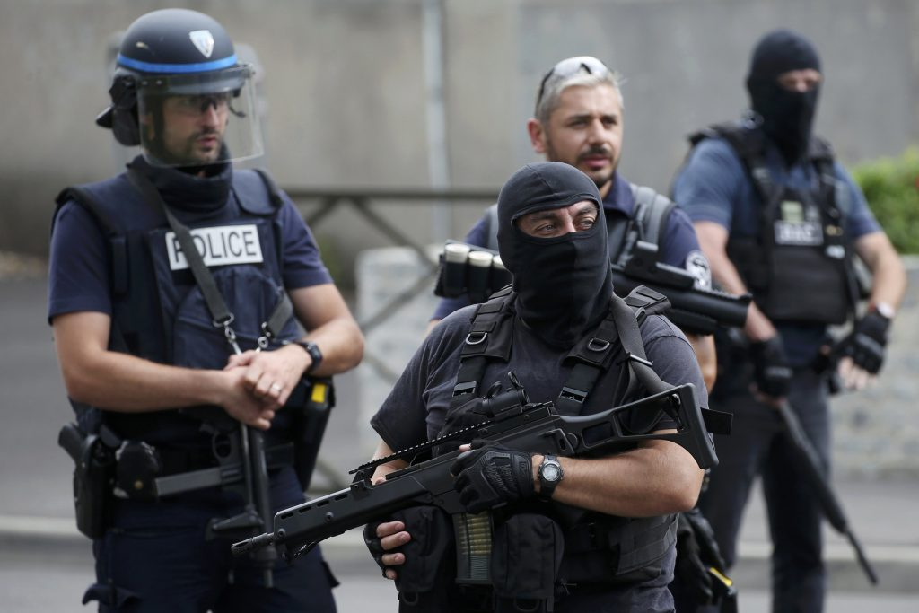French police and anti-crime brigade (BAC) members secure a street as they carried out a counter-terrorism swoop at different locations in Argenteuil, a suburb north of Paris, France, July 21, 2016. REUTERS/Charles Platiau