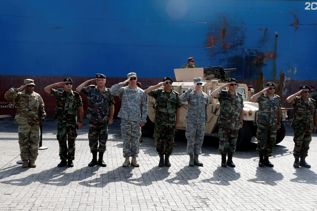 Lebanese Army soldiers and American soldiers salute during a ceremony after unloading ammunition and weapons, part of a military donation from the U.S. government to the Lebanese army at Beirut's port, Lebanon, August 9, 2016. REUTERS/Mohamed Azakir