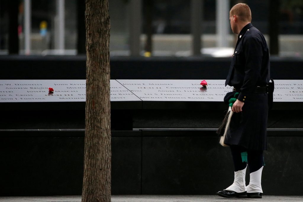 A member of the NYPD Emerald Society Pipe & Drum Band at the memorial before the start of the ceremony marking the 15th anniversary of the 9/11/01 attacks, at The National September 11 Memorial and Museum in Lower Manhattan. (Reuters/Brendan McDermid)