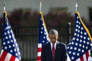 President Barack Obama bows his head for a moment of silence before delivering remarks at the 9/11 ceremony at the Pentagon on Sunday. (AP Photo/Cliff Owen)
