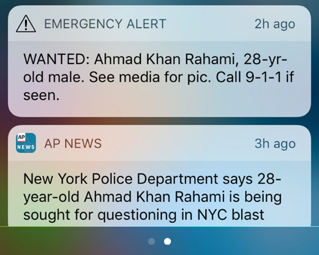 This frame grab from a cellphone shows an emergency alert along with a news alert on Monday, Sept. 19, 2016, about a man wanted in connection with explosions in the New York City metropolitan area. (AP Photo)