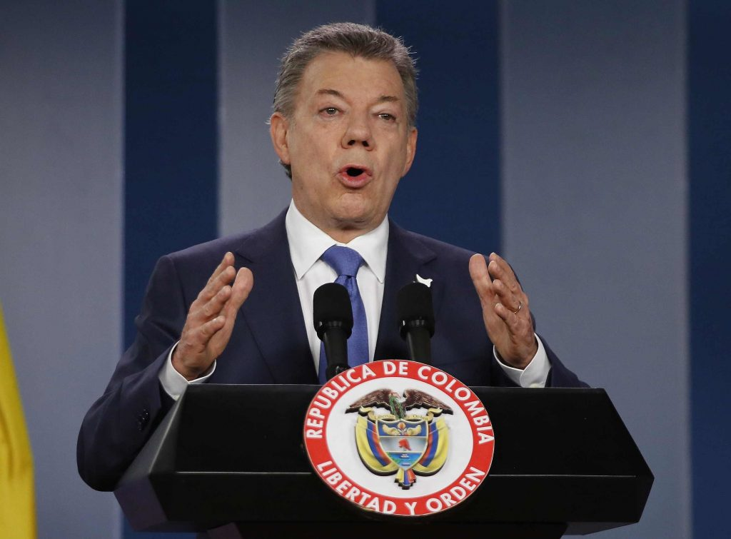 FILE - In this Wednesday, Oct. 4, 2016 file photo Colombia's President Juan Manuel Santos delivers a statement to the press after meeting with former President Alvaro Uribe and other opposition leaders at the presidential palace in Bogota, Colombia. Colombian President Juan Manuel Santos has won Nobel Peace Prize it was announced on Friday Oct. 7, 2016. (AP Photo/Fernando Vergara, File)