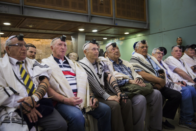Holocaust survivors celebrate their belated Bar Mitzvah at the Kosel. Photo by Shlomi Cohen/Flash90