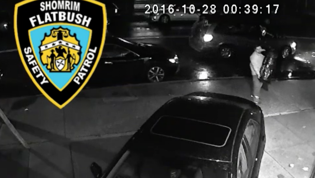 A screenshot of surveillance-camera footage showing the sifrei Torah being returned Friday morning. (Flatbush Shomrim)