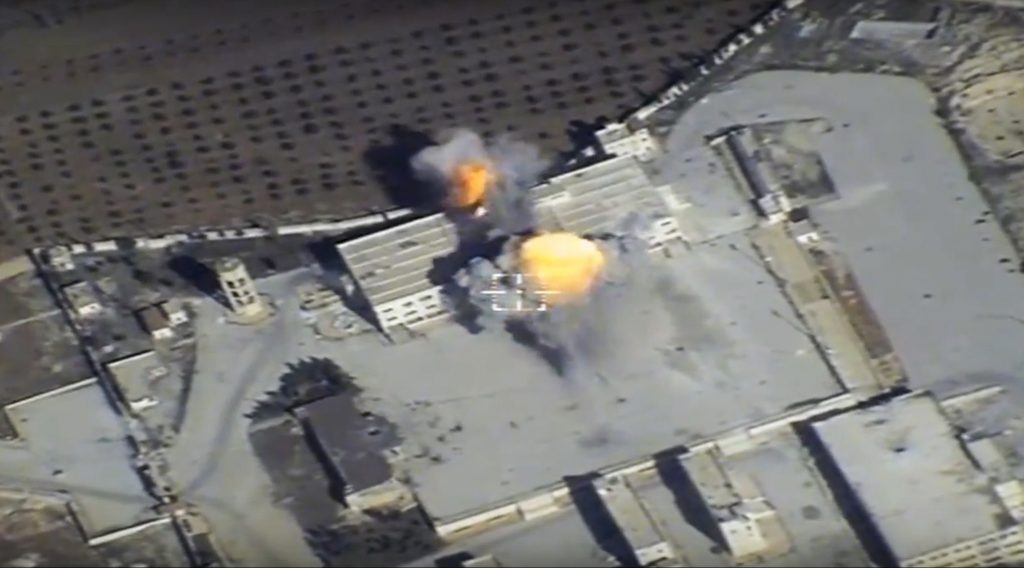 This photo made from the footage taken from Russian Defense Ministry official web site on Thursday, Nov. 17, 2016, showing a target in Syria hit by Russian missile. The Russian Defense Ministry said Thursday long-range bombers dispatched from Russia fired cruise missiles at Islamic State and al-Qaida targets in Syria. (Russian Defense Ministry Press Service/ Photo via AP)