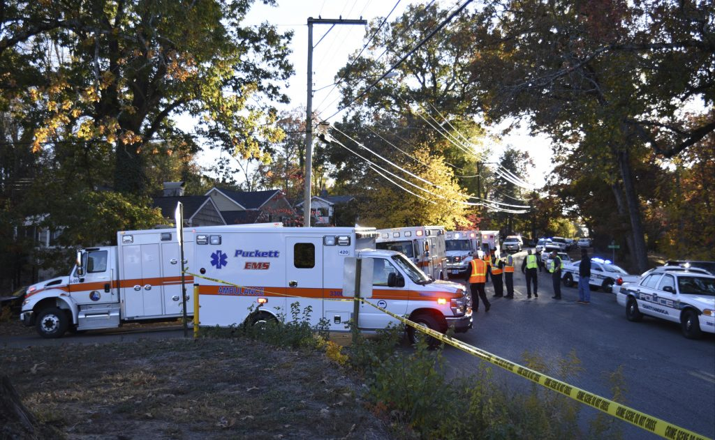 Emergency personnel work the scene of a fatal elementary school bus crash in Chattanooga, Tenn., Monday, Nov. 21, 2016. In a news conference Monday, Assistant Chief Tracy Arnold said there were multiple fatalities in the crash. (Angela Lewis Foster/Chattanooga Times Free Press via AP)