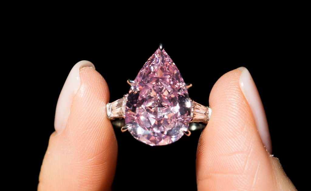 The Fancy Vivid Pink pear-shaped diamond of 9.14 carats is expected to realize $16–18 million when it goes for auction in Geneva Tuesday. (Jean-Christophe Bott/Keystone via AP)