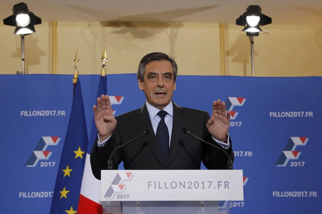 Francois Fillon, former French prime minister and member of Les Republicains political party, reacts as he delivers his speech after partial results in the second round for the French center-right presidential primary election in Paris, France, November 27, 2016. Fillon, a socially conservative free-marketeer, is to be the presidential candidate of the French centre-right in next year's election, according to partial results of a primaries' second-round vote showed on Sunday. REUTERS/Christian Hartmann