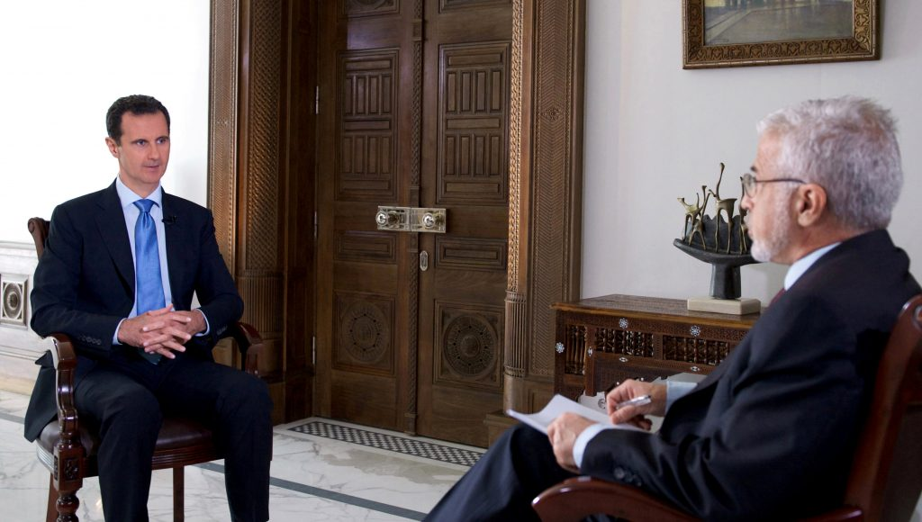 Syria's President Bashar al-Assad attends an interview with a Portuguese television channel in this handout picture provided by SANA on November 15, 2016. SANA/Handout via REUTERS ATTENTION EDITORS - THIS PICTURE WAS PROVIDED BY A THIRD PARTY. REUTERS IS UNABLE TO INDEPENDENTLY VERIFY THE AUTHENTICITY, CONTENT, LOCATION OR DATE OF THIS IMAGE. THIS IMAGE HAS BEEN SUPPLIED BY A THIRD PARTY. IT IS DISTRIBUTED, EXACTLY AS RECEIVED BY REUTERS, AS A SERVICE TO CLIENTS. FOR EDITORIAL USE ONLY.