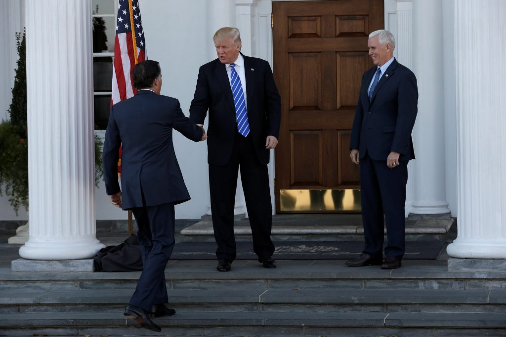 U.S. President-elect Donald Trump and Vice President-elect Mike Pence greet former Massachusetts Governor Mitt Romney (L) as he arrives for their meeting at the the main clubhouse at Trump National Golf Club in Bedminster, New Jersey, U.S., November 19, 2016. REUTERS/Mike Segar