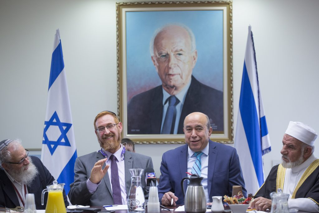 Likud MK Yehuda Glick (2nd L) and Zionist Camp MK Zouheir Bahloul (2nd R) hold a meeting promoting interfaith following the continued promotion of the Muezzin law, a bill which intends to ban loudspeakers at mosques, in the Israeli parliament on december 05, 2016. (Miriam Alster/Flash90)