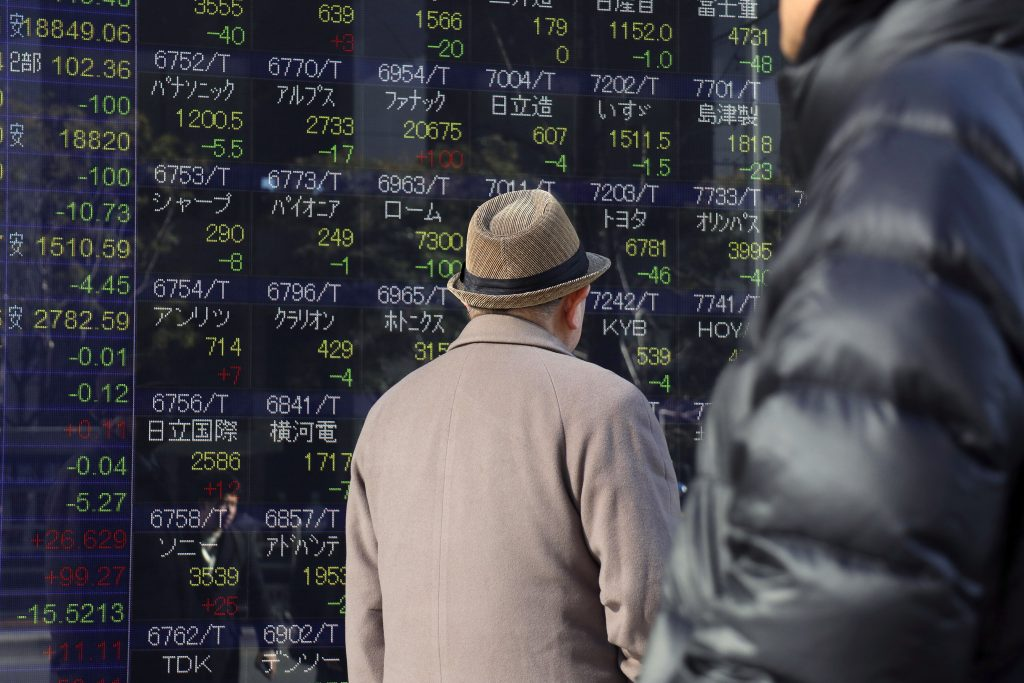 Asia tracks French election rally; weak yen lifts Tokyo