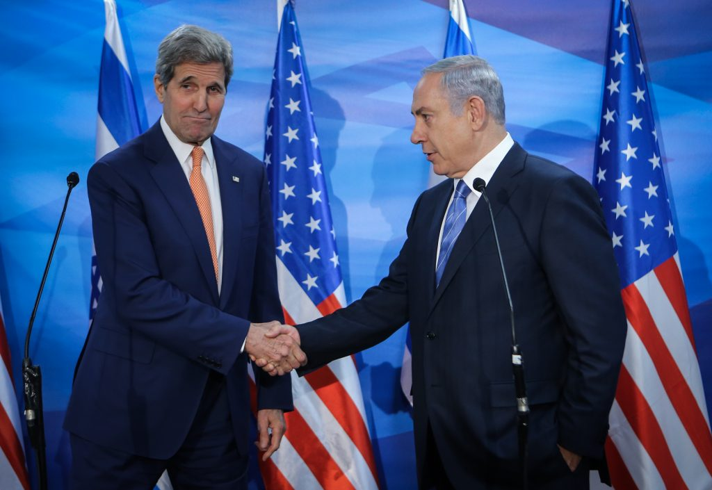 FILE - Former Secretary of State, John Kerry, meets with Prime Minister Binyamin Netanyahu during an official visit to the region, on November 24, 2015. (Alex Kolomoisky/POOL/FILE)