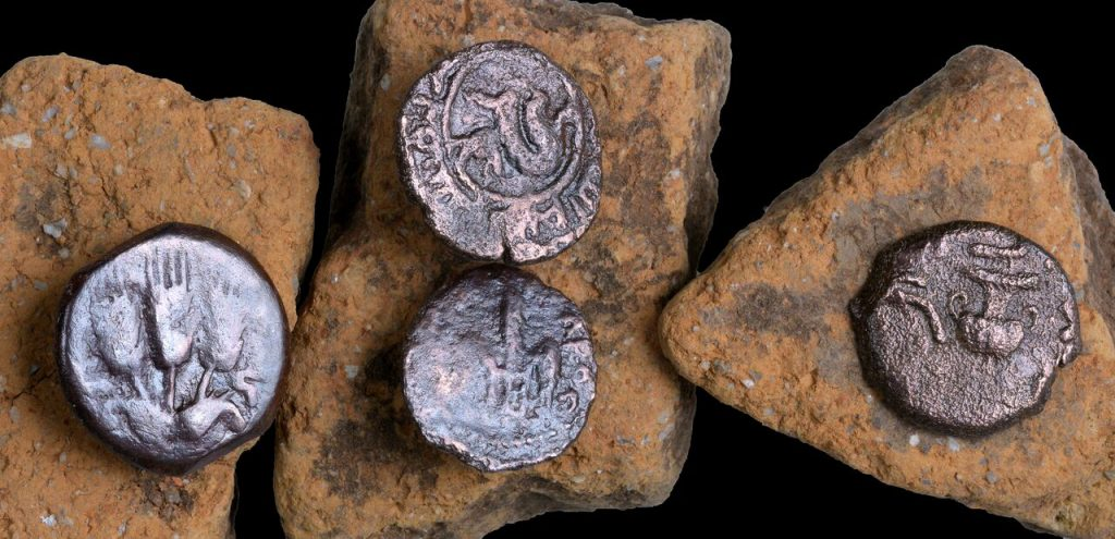 The ancient coins that were discovered in the excavation of an ancient Roman road near Beit Shemesh