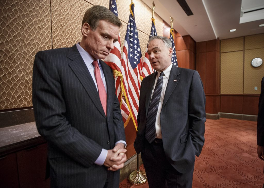 Sen. Mark Warner D-Va. left and Sen. Tim Kaine D-Va. right on Capitol Hill in Feb. 2015
