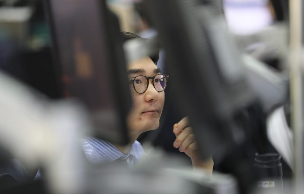 Asia stocks slip as high bond yields weigh, dollar steadies