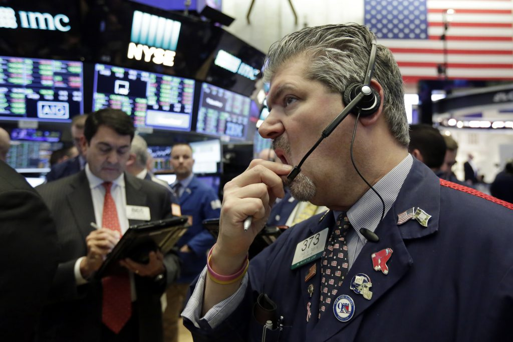 Wall Street closes in correction territory as stocks tumble