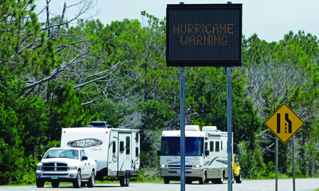 A sign warns travelers as recreational vehicles arrive in Nags Head, N.C., after departing Hatteras Island Thursday (AP Photo/Gerry Broome)