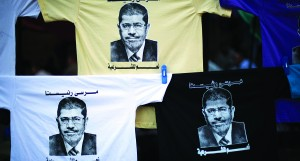 T-shirts with the face of Egypt's ousted President Mohammed Morsi are displayed for sale at Nasr City, where protesters have installed a camp and hold daily rallies, in Cairo, Egypt, Monday (AP Photo/Manu Brabo)