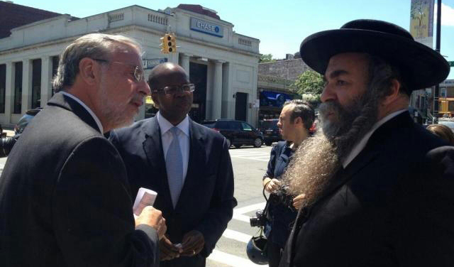 Assemblyman Dov Hikind (L) on 13th Avenue on Tuesday endorsing Ken Thompson (2nd L) for Brooklyn district attorney.