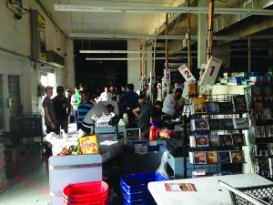 Shoppers at Landau's Supermarket in Woodridge on Wednesday after a blackout rolled through the area. They had a separate generator for the cash registers. (JDN)