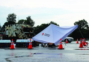 The awning for an American Red Cross water distribution station collapsed Wednesday after three Rotterdam Highway Department workers were struck by lightning. (AP Photo/The Albany Times Union, Selby Smith)