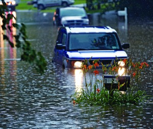 Two cars sit flooded Wednesday afternoon as a mailbox is barely visible above floodwaters in Niskayuna, N.Y. (AP Photo/The Albany Times Union, Skip Dickstein)
