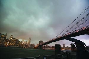 A man stands underneath the Brooklyn Bridge Wednesday. (Reuters/Lucas Jackson)