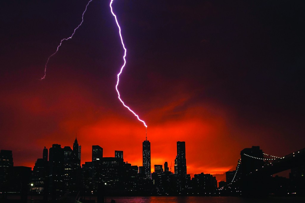 Lightning strikes One World Trade Center on Wednesday as the sun sets in New York. (Reuters/Lucas Jackson)