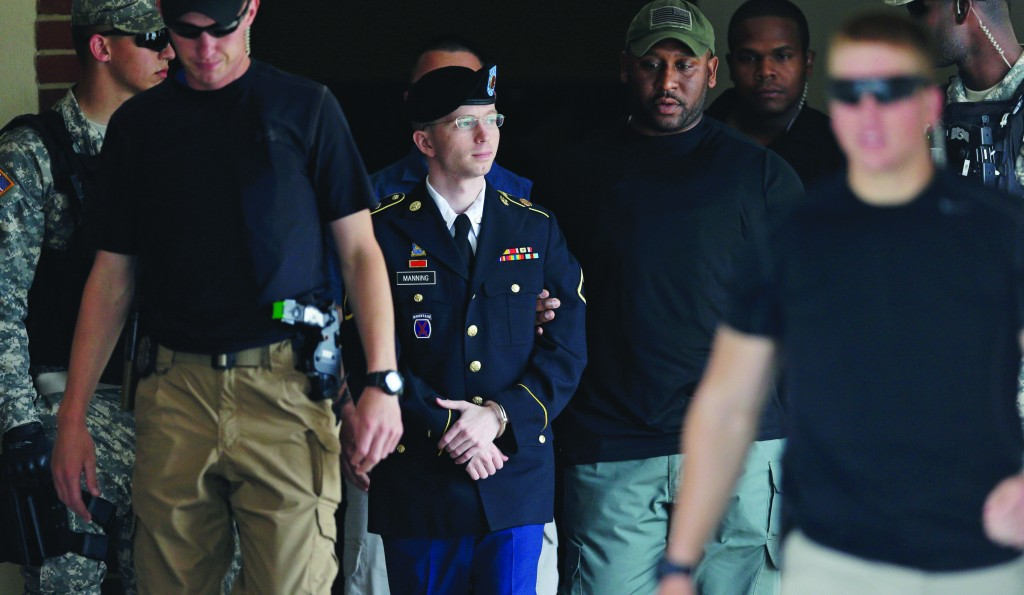 Army Pfc. Bradley Manning is escorted out of a courthouse in Fort Meade, Md., Tuesday, after receiving a verdict in his court martial. (AP Photo/Patrick Semansk)