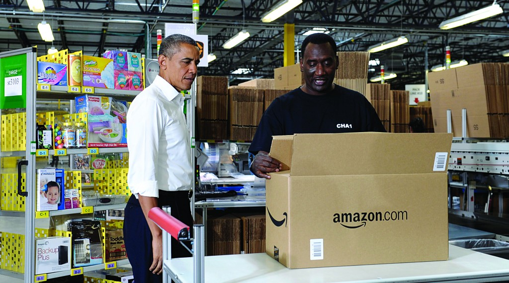 President Barack Obama talks with Eric Phillips as he tours the Amazon fulfillment center in Chattanooga, Tenn., Tuesday. (AP Photo/Susan Walsh)