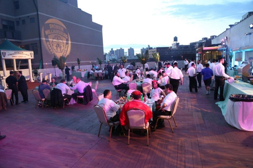 At the Shomrim reunion Sunday on a Williamsburg rooftop. (JDN)