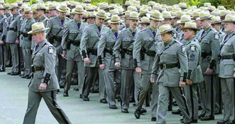 New York State troopers at the funeral Tuesday of Winston I. Martindale, who died from injuries suffered two years ago at the scene of a double plane crash.(Rabbi Abe Friedman)