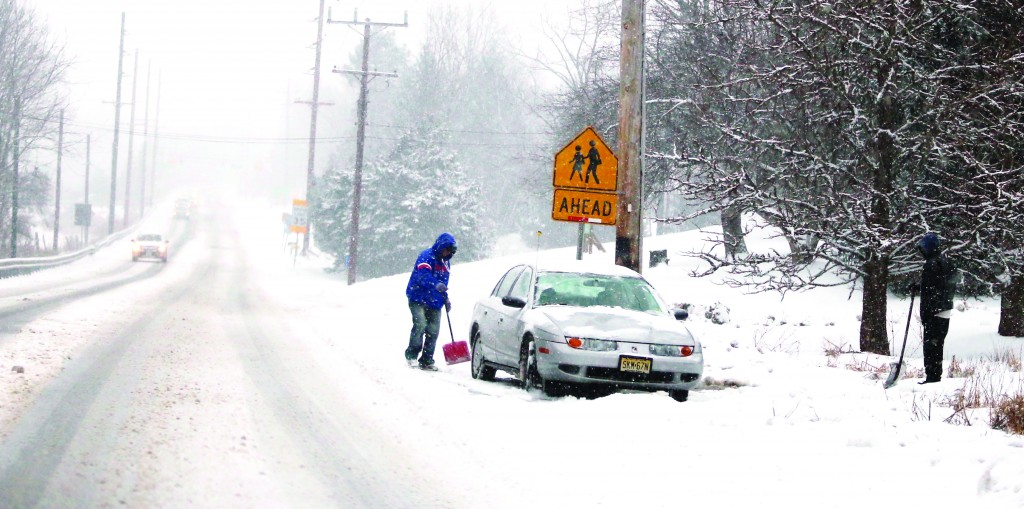 A person digs out a car in Newton, N.J. (APPhoto/The New Jersey Herald, Amy Herzog)