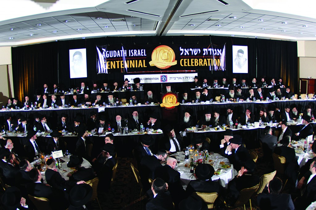 The dais and partial view of the crowd at the centennial banquet melaveh malkah marking 100 years since the founding of Agudas Yisrael in Katowice, Poland, on Motzoei Shabbos at the 90th National Convention of Agudath Israel of America.