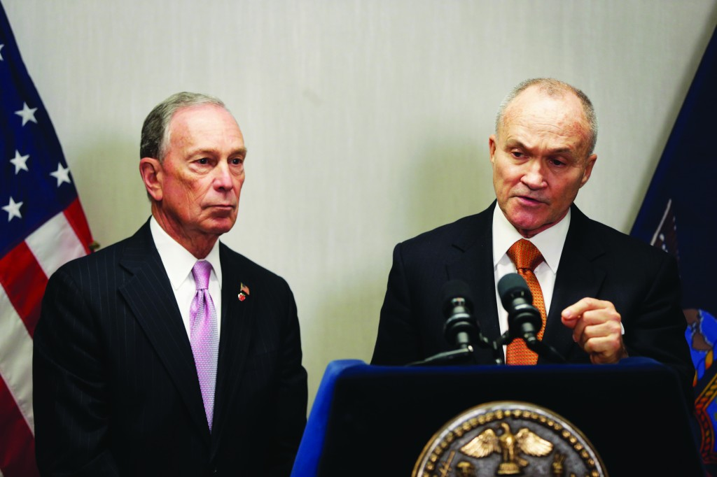 New York City Mayor Michael Bloomberg (L) and Police Commissioner Raymond Kelly speak to the media after a Police Academy graduation ceremony in NY, Friday. The number of NYC murders is expected to hit a record low this year, and shootings are at their lowest point in at least 18 years. Mayor Michael Bloomberg and Police Commissioner Raymond Kelly credited police efforts, including the controversial tactic known as stop and frisk. (AP Photo/Seth Wenig)