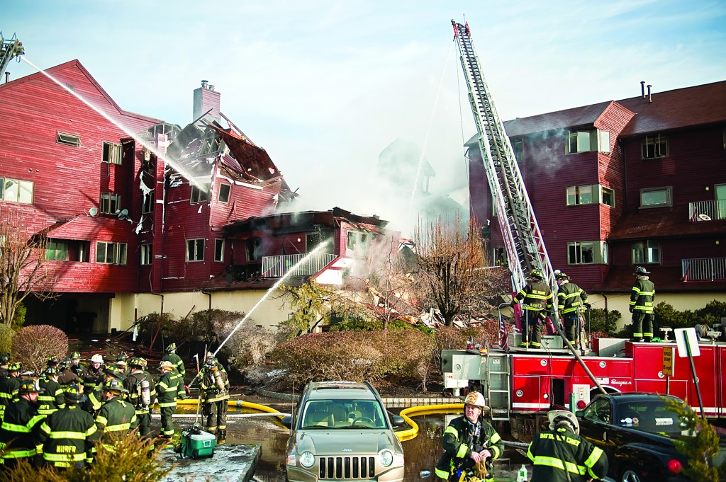 Firefighters respond to a six-alarm fire at the Roc Harbour condominiums in North Bergen on Monday. It took about 100 firefighters several hours Monday to contain the huge early-morning fire. Fire officials said no major injuries were reported during the blaze. (AP Photo/The Jersey Journal, Lauren Casselberry)