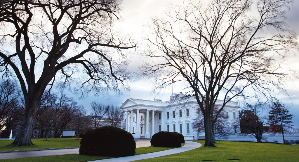 Clouds roil over the White House as politicians scramble to try to avert the 'fiscal cliff,' a series of tax increases and spending cuts set to take effect Jan. 1. (AP Photo/Jacquelyn Martin)