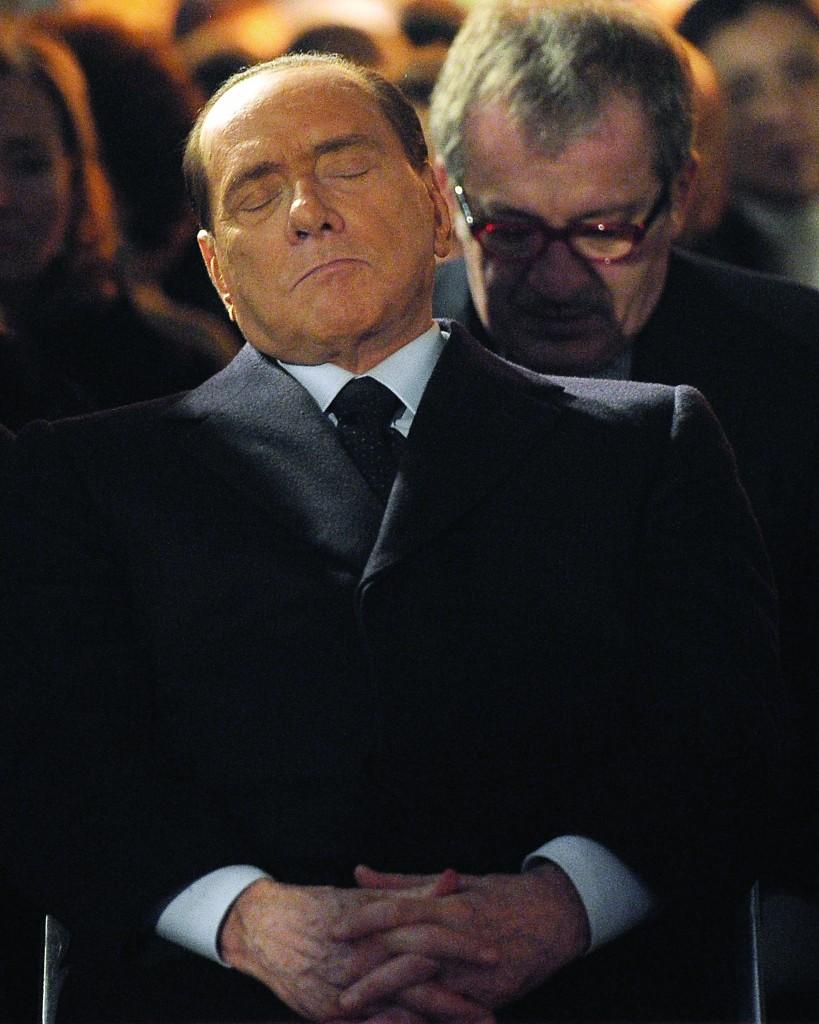 Former Italian premier Silvio Berlusconi dozes off at a ceremony commemorating the Holocaust in Milan, Italy, Sunday. (AP Photo/Antonio Calanni)