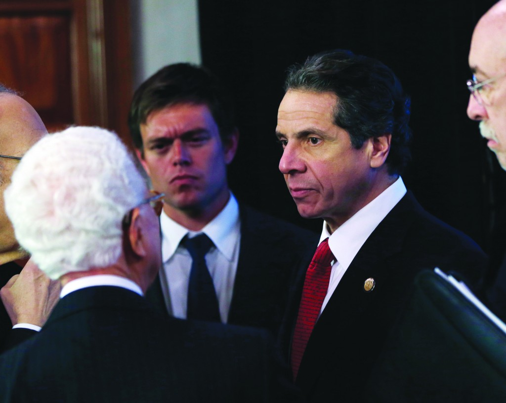 New York Gov. Andrew Cuomo talks to NYS Responds and NYS Ready Commissions members following a meeting in the Red Room at the Capitol yesterday. (AP Photo/Mike Groll)