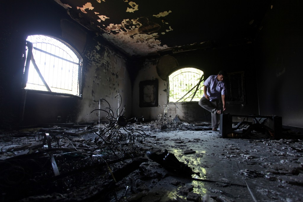 In this photo, a Libyan man investigates the inside of the U.S. Consulate after an attack that killed four Americans, including Ambassador Chris Stevens, on the night of Tuesday, Sept. 11, 2012, in Benghazi, Libya. (AP Photo/Mohammad Hannon, File)