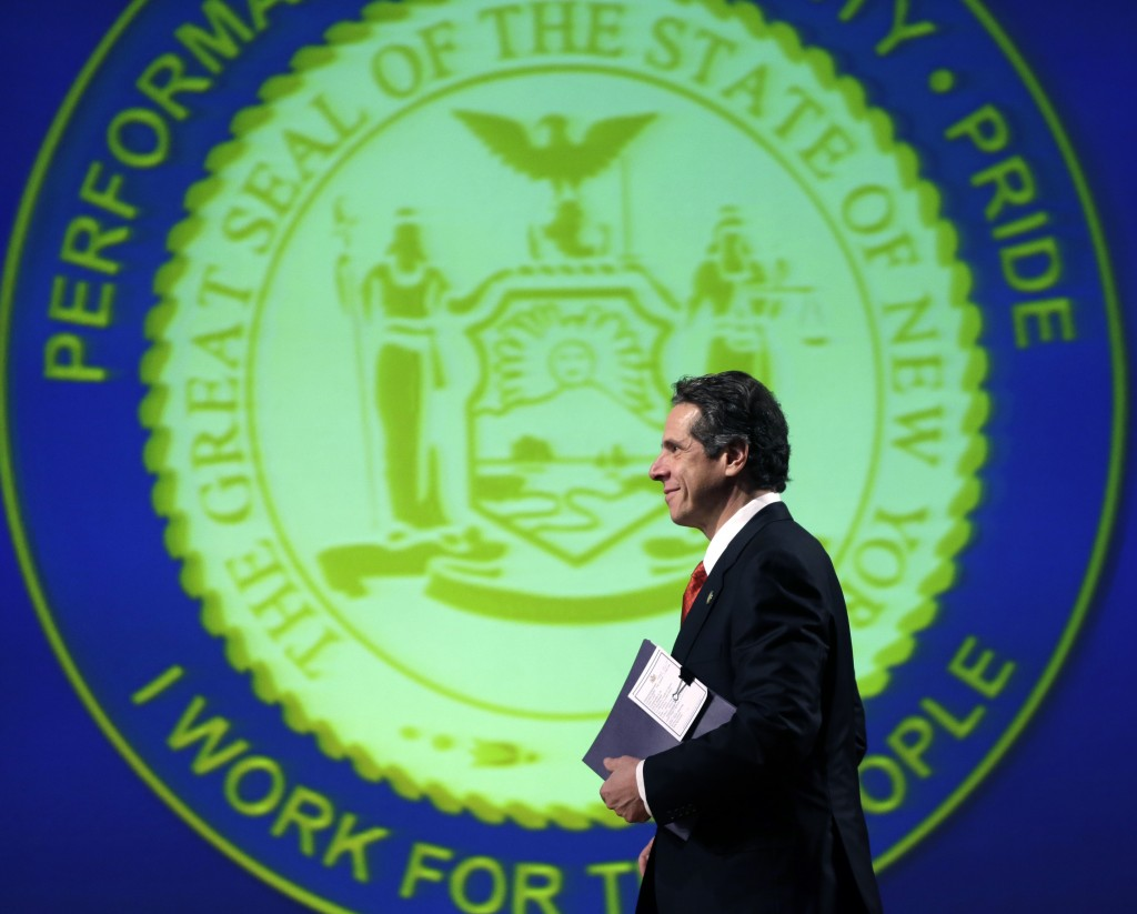 New York Gov. Andrew Cuomo walks to the podium to deliver his third State of the State address at the Empire State Plaza Convention Center. (AP Photo/Mike Groll)