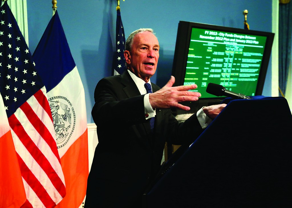 New York Mayor Michael Bloomberg unveils a proposed budget that totals just over $70 billion, in the Blue Room of New York's City Hall, Tuesday. It's Mayor Bloomberg's final budget plan. (AP Photo/Richard Drew, Pool)