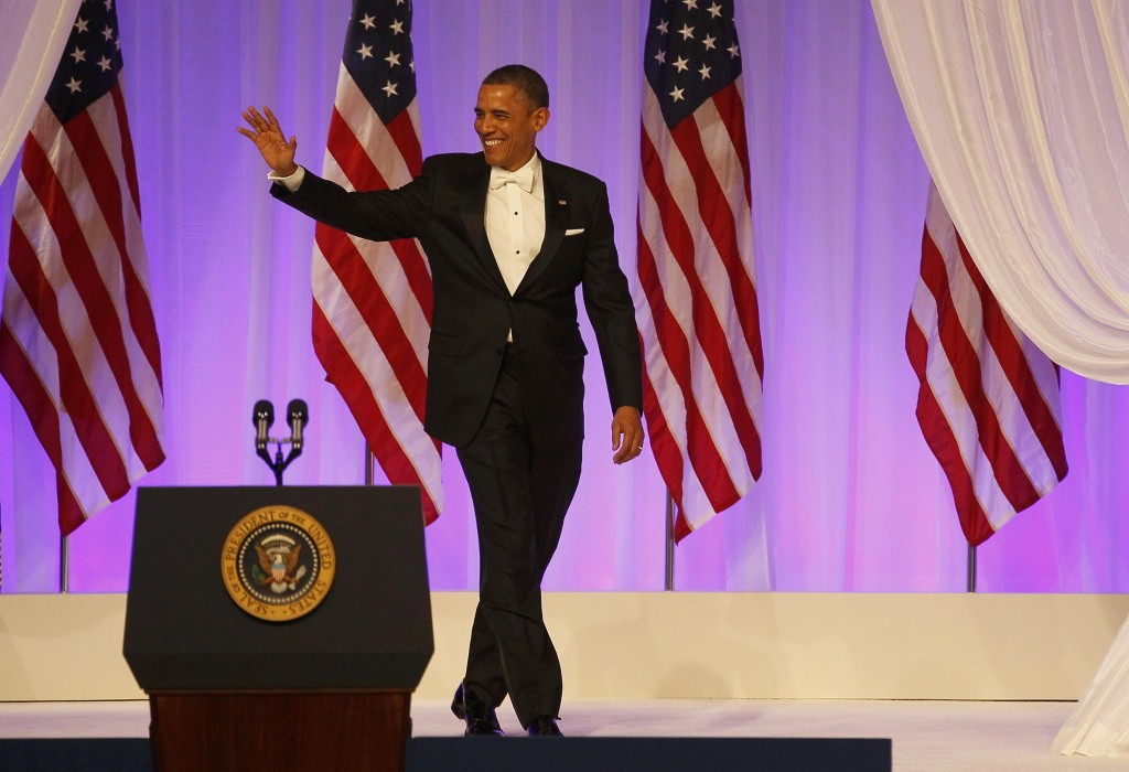 President Obama waves to the crowd at the Commander in Chief's Ball during presidential inauguration ceremonies in Washington, Tuesday. (REUTERS/Rick Wilking)